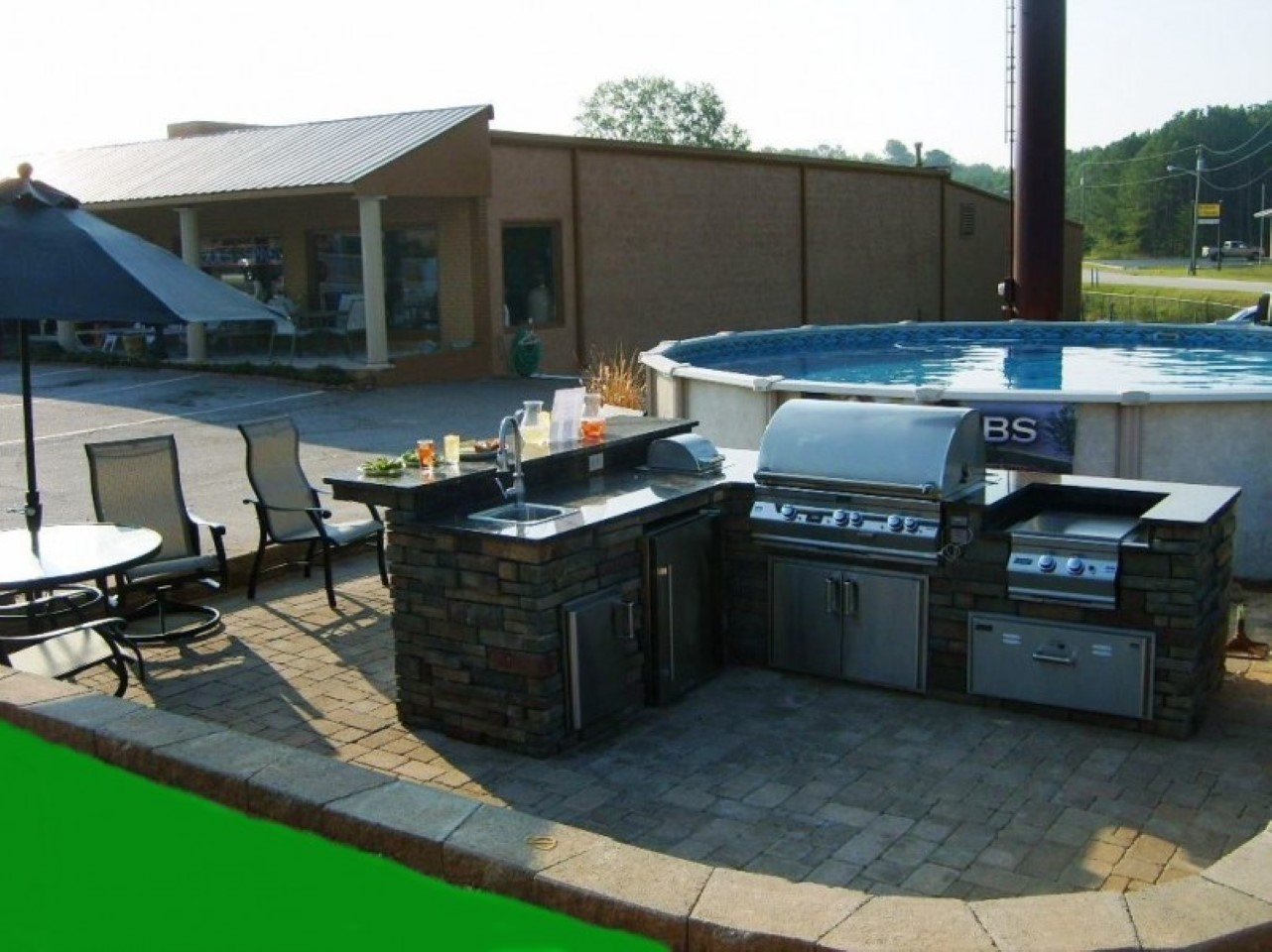 modern-round-above-ground-pool-design-by-outstanding-outdoor-kitchen-plus-metal-chairs-and-stainless-steel-grill